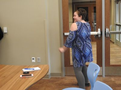 A student practices salsa dancing during the Amazing chef class